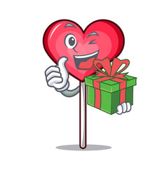 With gift heart lollipop mascot cartoon vector