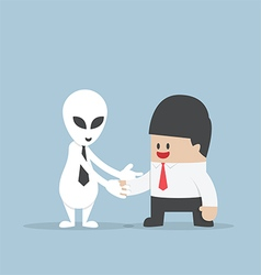 Businessman shaking hands with Alien vector image