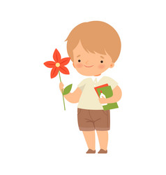 Little boy showing handcrafted paper flower vector