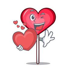 With heart heart lollipop mascot cartoon vector