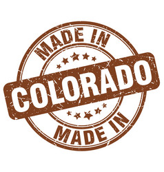 Made in colorado brown grunge round stamp vector