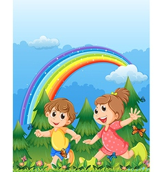 Kids playing near the garden with a rainbow in the vector image