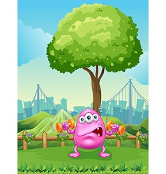 A tired monster exercising under the tree vector