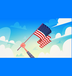 hand holding usa flag over blue sky national vector image