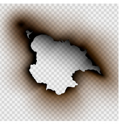 Hole torn in ripped paper with burnt and flame vector