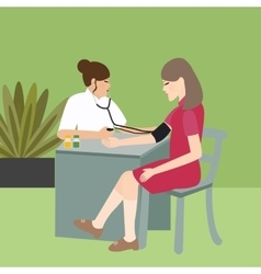 woman check blood pressure with nurse medical vector image vector image