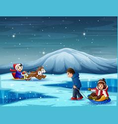 Happy children playing in winter season vector