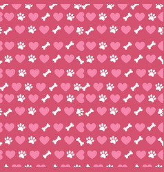 Seamless pattern with hearts bones and paws vector