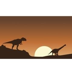 Silhouette of mapusaurus and argentinosaurus vector