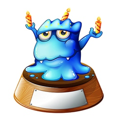 A monster with candles standing above an empty vector image