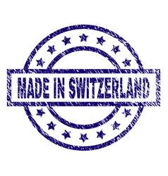 Grunge textured made in switzerland stamp seal vector