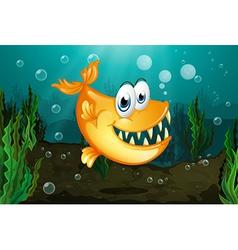 A yellow piranha near the seaweeds vector image