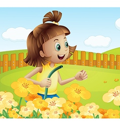 A girl watering the plants in the garden vector image