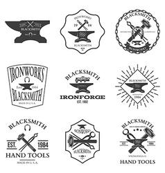 Set of vintage blacksmith labels and design vector