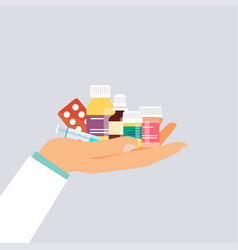 Doctor hand holding different medical pills vector