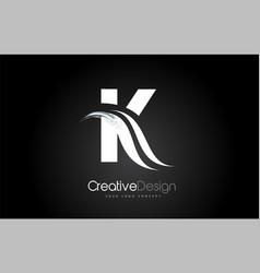 K letter design brush paint stroke on black vector