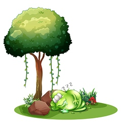 A fat green monster sleeping under the tree vector image