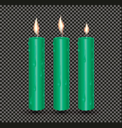 Realistic green glowing candles with melted wax vector
