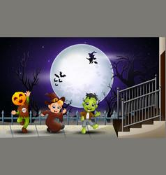 happy kids halloween in the full moon background vector image