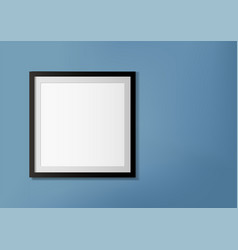 Photo frame on blue wall vector