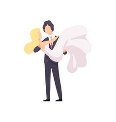 elegant groom holding his beautiful bride in his vector image