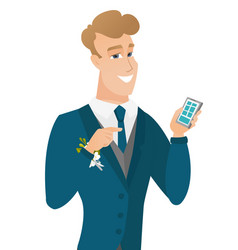 Young caucasian groom holding a mobile phone vector