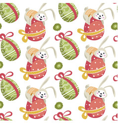 easter bunny sitting on decorated egg pattern vector image