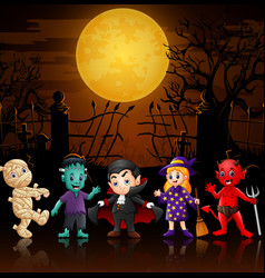 Happy little kids in halloween costumes vector