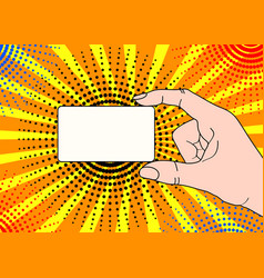 male hand with holding a card in pop art comic vector image
