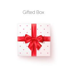 white gift box with red silk bow in realistic vector image