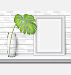 Monstera leaf on a white table vector