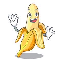 Waving character banana in the fruit market vector