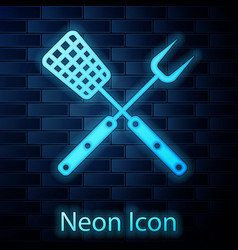 glowing neon crossed fork and spatula icon vector image