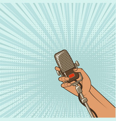 Music background male hand with retro microphone vector