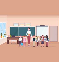 Woman teacher with mix race pupils standing vector