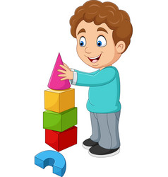 Cartoon boy playing with building blocks vector