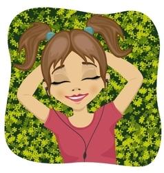little girl lying on grass listening to music vector image vector image