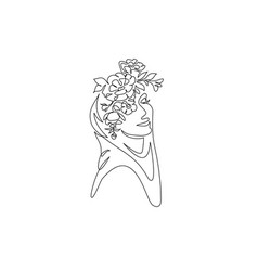 Young happy woman in hijab with flowers on her vector