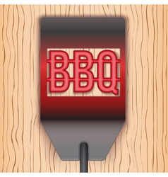 Barbecue hot metal spatula on wooden background vector image vector image
