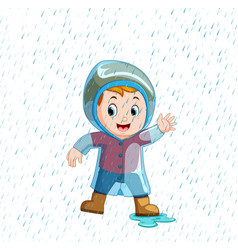 little boy wearing blue raincoat and heavy rain vector image