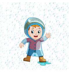 little boy wearing blue raincoat and heavy rain vector image