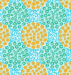 Painted orange and green dotted circles on blue vector
