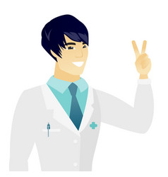 Young asian doctor showing the victory gesture vector