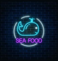Neon glowing sign of sea food with blue whale in vector