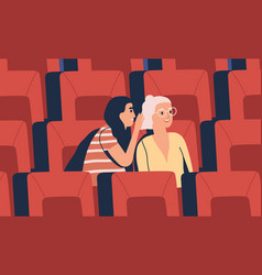 two young girl friends whispering at movie theater vector image