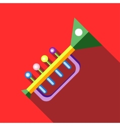 Children s toy musical trumpet on red background vector image vector image