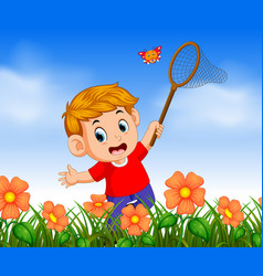 Boy wearing red shirt catching butterfly vector