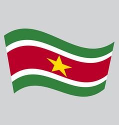 Flag of suriname waving on gray background vector