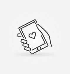 Hand holding smartphone icon in thin line vector