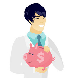 young asian doctor holding a piggy bank vector image